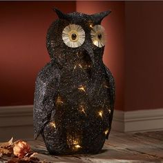 "Lighted Black Owl Coal-black owl with a glittery sheen is crafted from sisal, metal, resin and wire. LED lights are powered by 3 AA batteries (not included). 11"" l x 8"" w x 20"" h."