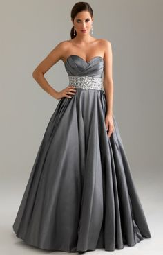 Night Moves 6416 is the perfect Ball Gown look for Prom or a Military Ball!  Feel like you're going on the Red Carpet in this amazing satin blend Ball Gown style dress!  A Layered crossing bodice adds texture and glam to the top with a sweetheart neckline to define your curves. A Rhinestone embellished belt creates a perfect waistline and accentuates the smallest part of your body for a flattering figure.  A sloping back gives this dress the small amount of sex appeal that makes your gown unf...