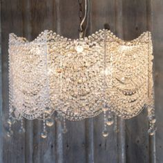 a chandelier of lace and beads and across the bottoms to diffuse the light