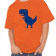 Camiseta infantil  con la representación de un T-Rex en formato pixels similar a los juegos de 8bits.   Dale un toque divertido a tu día a día con esta camiseta original con ilustraciones modernas. Camiseta baratas de alta calidad y fácil lavado.