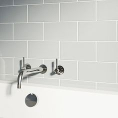 close up of light grey metro tile with bath