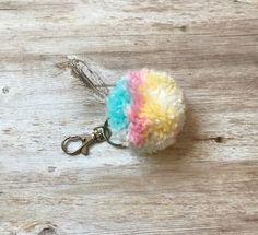 A personal favorite from my Etsy shop https://www.etsy.com/listing/548133935/cotton-candy-pom-pom-keychain-handbag