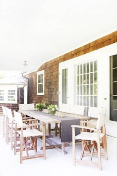 ED: What's your favorite room in the house? LJ: My favorite room is ironically not in the house. Morning (coffee), noon (rosé), and night (vodka), you will generally find me sitting at the weathered wooden tables on the sun porch.   - ELLEDecor.com