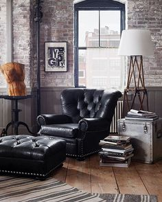 Inspired by a vintage motorcycle jacket, distressed black leather lends a laid back vibe to the iconic #RLHome Writer's Chair.