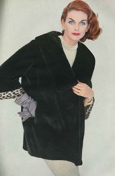 You've got to love the mix of pearls, ginger hair, and leopard trimmed cuffs…