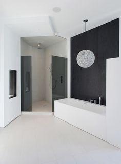 black and white bathroom with an asymmetrical floor plan