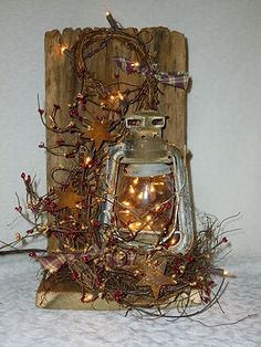 barnwood box holding lantern wrapped in grapevine/berry garland... brilliant