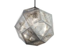 Tom Dixon Mid Steel Etch Pendant Light: Etch pendants are inspired by geometry and pure mathematics. Finely etched lattices of sheet metal compose a geodesic sphere, creating multifarious shafts of golden light and intricate shadows. Etch pendants are beautiful hung together using the Tom Dixon pendant system, or sinlgy above a dining table.