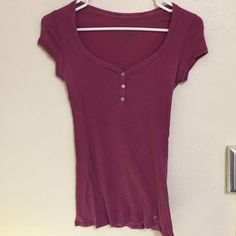 American eagle tee Has been worn and washed many times! Has a hole in the front. It is very light and great to wear a tank under! American Eagle Outfitters Tops Tees - Short Sleeve