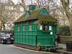 Why are there little green huts all over London? To keep cabbies from being wet or drunk.