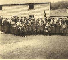 Athapascan and Eskimo children pose outside Holy Cross Mission School, lower Yukon River, Alaska, ca. 1914