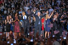 President Barack Obama and wife Michelle hold hands with Vice President Joe Biden and his wife Jill following Obama's victory speech to supporters in Chicago early Wednesday, Nov. 7 2012.