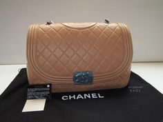 NEW Boy Chanel Bag arriving for Fall 2012. This large flap tote features a much rounder shape, but with consistent features as the original boy bag, namely: front quilted tote, CC plated front clasp, Chanel logo on the top of the bag and leather strap with signature chain.