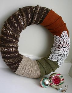 Sweater wreath - I like this idea but I'd go with brighter colors..