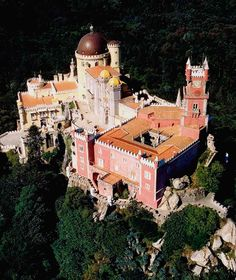 """Palacio-da-Pena-1 - Palácio da Pena, or """"Castelo da Pena"""" as it is more commonly known, is the most complete and notable example of Portuguese architecture in the Romantic period.  The Palace dates back to 1839, when the King Consort Dom Fernando II of Saxe Coburg-Gotha (1816-1885) bought the ruins of the Hieronymite Monastery of Nossa Senhora da Pena and started to adapt it for use as a residence, according to his Romantic taste."""