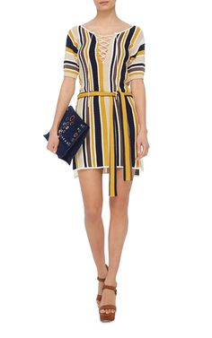 This **Frame Denim** dress is crafted in a midweight striped knit and features a lace up front.