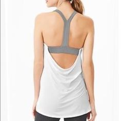 GapFit scoop back tank GapFit double layer scoop back tank top. Great condition, built in bra, SO comfortable and gets SO many compliments. Lightly worn, no holes, snags, pilling or stains. GAP Tops Tank Tops