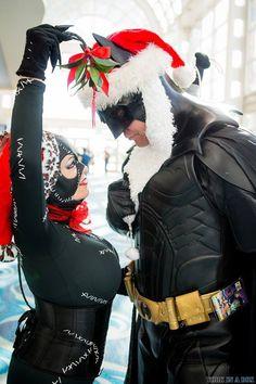 Catwoman and Batman under the Christmas mistletoe #cosplay