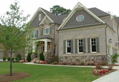 Suburban Home, Stone Watertable & Natural Cedar Shakes - Traditional Exterior By Dream With Jeannie