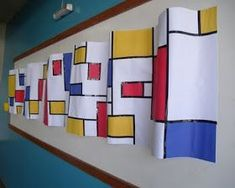 Art Room - Mondrian Wave - neat display, would be cool with an op art or escher lesson too. Piet Mondrian, Mondrian Kunst, Mondrian Dress, Group Art Projects, Collaborative Art Projects, School Art Projects, Mondrian Art Projects, Kindergarten Art, Preschool Art