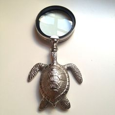 "Turtle Magnifying glass ($34) - 6"" tall.  Nickel plated"