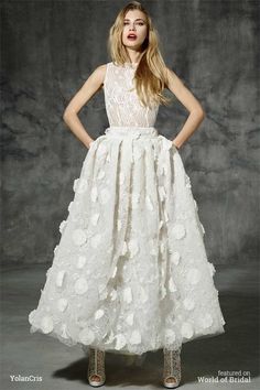 Modern wedding dress boho folk style, ideal for wearing with boots, ankle-lenght skirt. The top of the dress is similar to a lace blouse and skirt is made of 3D flowers sewn by hand. A trendy wedding dress full of style, very seventies.