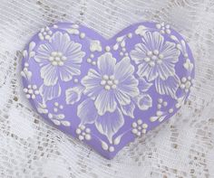 Hand Painted Soft Lavender MUD Floral Cookie 9. $15,00, via Etsy.
