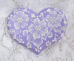 Hand Painted Soft Lavender MUD Floral Cookie 9. $15,00, via Etsy.
