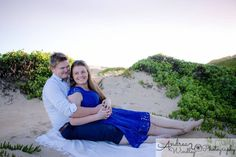Couples photography Newcastle and Lake Macquarie NSW Australia. Captured at sunset at Nobbys Beach. First wedding anniversary photoshoot.