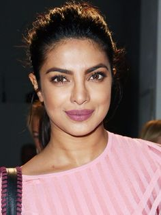 How pretty is this pink lipstick on Priyanka Chopra at the Altuzarra show? A subtle brown smoky eye completes the look.