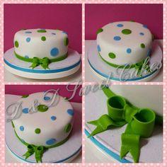 Fondant dots cake with fondant bow