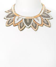 such a unique bib necklace.  Love!