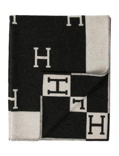 Grey and creme Hermès wool Avalon blanket with contrast stitching throughout edges.