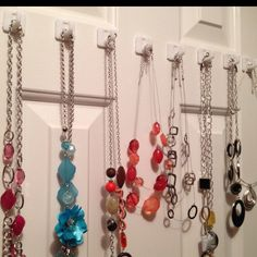 97 cent way to store necklaces. Found these hooks at Walmart and put them on the inside of my closet door. Perfect.