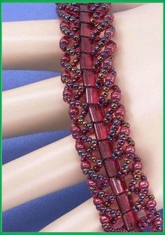 """Jewelry is made with small beads. Some are glass or stone. Adult supervision is recommended. This bracelet is made with Miyuki 11/0 garnet lined ruby and 8/0 cranberry gold luster glass seed beads along with 4mm garnet gold luster glass tila beads and hooks with a fold over clasp. Measures approx. 7 1/8"""" long by 5/8"""" wide and is a pattern designed by: Miss Ann. Priced at only $27.00 with """"FREE SHIPPING"""""""