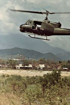 Huey Sweeps the Sides of Route 1 North of Danang, Vietnam 1968.  #VietnamWarMemories .near DMZ, volatile area.