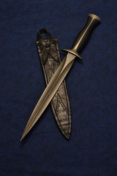 http://www.bladeforums.com/forums/showthread.php/1321583-Nathan-Carothers-Dagger-with-Sheath