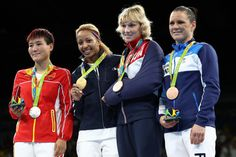 Silver medalist Junhua Yin of China, gold medalist Estelle Mossely of France, bronze medalist Anastasia Belyakova of Russia and Bronze medalist Mira Potkonen of Finland celebrate on the podium after the Women's Light Final Bout Day 14 of the Rio 2016 Olympic Games at the Riocentro arena on August 19, 2016 in Rio de Janeiro, Brazil.