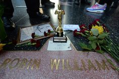 Flowers left by fans at his star on the Hollywood Walk of Fame after his death on Monday.