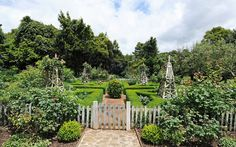 The property has dry-stone walls, a vegetable garden, citrus orchard and parterre, or ornamental garden (shown) with peony trees and roses.