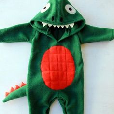 Learn how to make your own dinosaur costume for your baby or toddler! This easy DIY tutorial is perfect for those who love to sew!