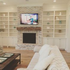 Built ins with a fireplace and the tv. love the fireplace & mantel . IG our_coastal_farmhouse . Fireplace Mantle Designs, Brick Fireplace Mantles, Fireplace Built Ins, Farmhouse Fireplace, Home Fireplace, Fireplace Remodel, Living Room With Fireplace, Wood Mantle, Fireplace Whitewash