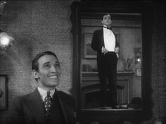 Edgar G. Robinson as Rico (in the mirror) in Little Caesar 1930 being worshiped by one of his stooges.