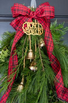 Evergreen Holiday Door Swag ...a beautiful, festive, and easy holiday door swag using what you have around the home and a few additional embellishments.