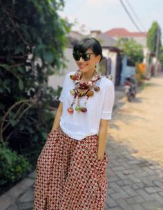 wearing Batik Amarillis' s Bohemian holiday skirt in kawung Banyumas, Mini BLT Triangle scarf,T shirt from Zara & Tom Ford glasses with clip on. it's oh so true when someone said style doesn't get more personal than designing the very clothes you want to wear...