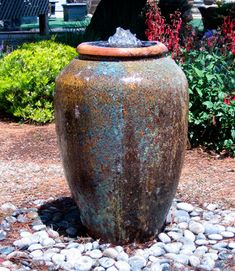 A striking pot with a bubbling fountain is another easy way to add the freshness of water to a small space
