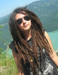 this is really weird because this girl kind of looks like me with my dreads down