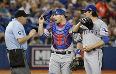 Texas Rangers catcher Chris Gimenez (38) has words with home plate umpire Dale Scott during Game 5 of the ALDS between the Texas Rangers and the Toronto Blue Jays at Rogers Centre in Toronto, Canada on Wednesday, October 14, 2015. (Louis DeLuca/The Dallas Morning News)