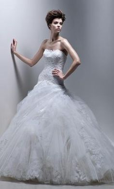 Enzoani Farlow wedding dress currently for sale at 65% off retail.