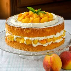 Bourbon Peach Shortcake - a light as air sponge cake gets layered with vanilla whipped cream and peaches which have been marinated in vanilla and bourbon.